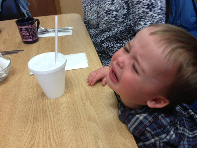 Grandma wouldn't let him spill his ice water all over her and the table.