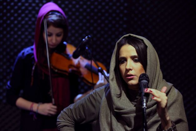 In this picture taken on Friday, Jan. 25, 2013, female Iranian back vocalist Azadeh Ettehad and vio