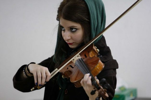 In this picture taken on Friday, Feb. 1, 2013, female Iranian violinist Nastaran Ghaffari practices
