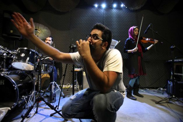 In this picture taken on Friday, Jan. 25, 2013, Iranian musician Danial Izadi performs with his har