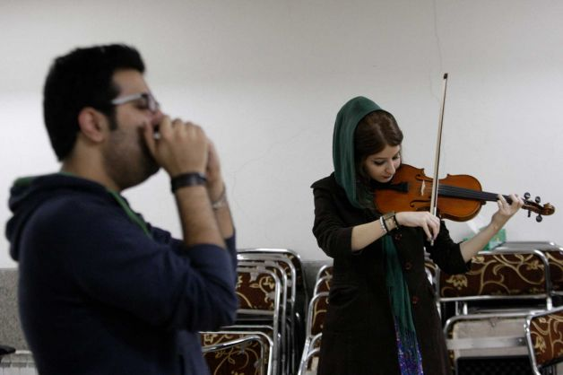 In this picture taken on Friday, Feb. 1, 2013, female Iranian violinist Nastaran Ghaffari and Dania