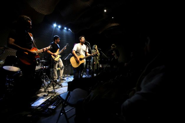 "In this picture taken on Friday, Jan. 25, 2013, members of an Iranian band called ""Accolade"" perfor"